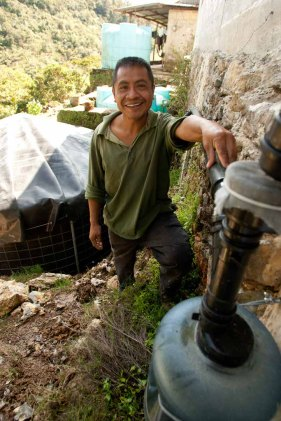 Leonardo proud showing his family's water harvesting system
